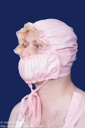 Latex bonnet with frills and removable mask